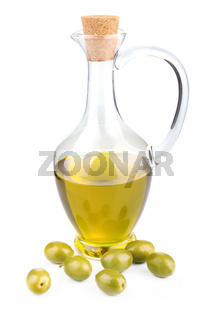 bottle of olive oil with berries isolated