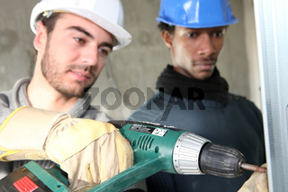 Electricians on construction site