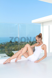 Sensual woman sitting at balcony with a view