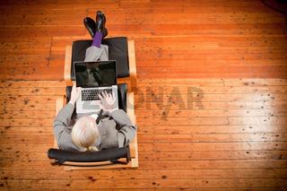 Businessman working on armchair
