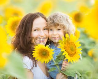 Womn and child in sunflower field