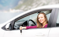 Woman with keys of new rental car
