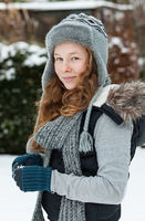 Teenager girl holding snowball