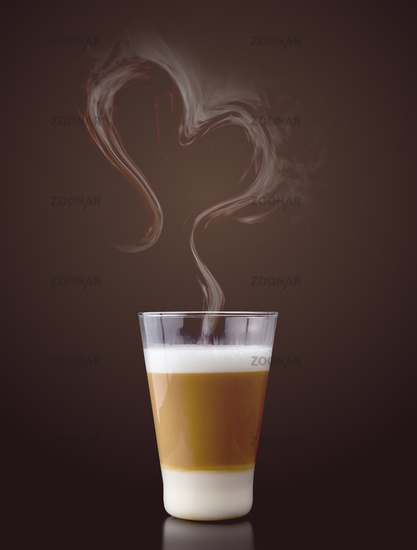 Latte macchiato with steam in heart shape