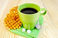 Wafers are round with a green mug and sugar