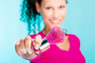 powder brush and woman