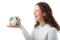 woman with little house on hand