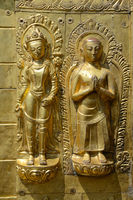 Two golden figures