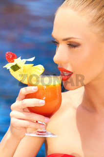 Woman sipping tropical cocktail