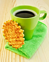 Waffles circle with a green mug on the board