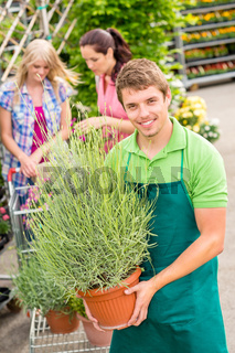 Garden centre worker hold potted plant