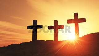 Abendrot mit drei Kreuzen am Hügel