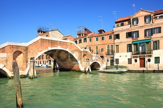Canal and small bridge in Venice, Italy.