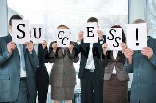 Successful business team holding white papers success