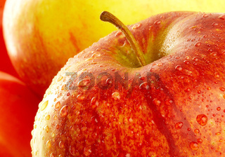 Fresh apple with drops of water.