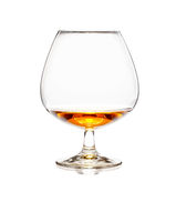 Glass of cognac or whiskey isolated on white background
