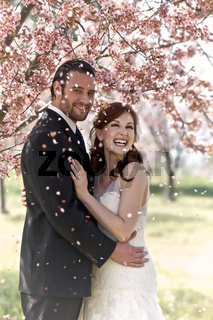 Couple Showered by Cherry Blossom Petals