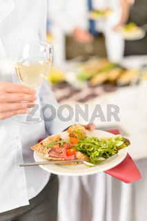 Business woman hold plate with catering food