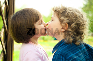 little boy kisses girl