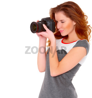 Woman in gray dress wit digtal camera on white