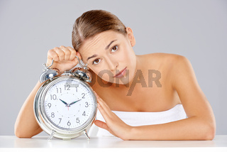 Bored young woman counting down the time