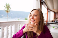 Woman in a restaurant is drinking coffee
