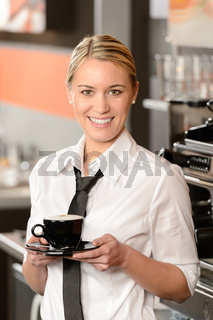 Young smiling waitress with cup of coffee