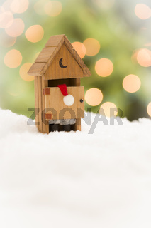 Santa in An Outhouse on Snow Over and Abstract Background