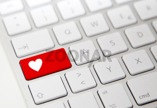 White computer keyboard with red 'heart' button