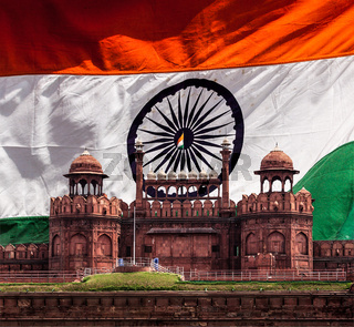 India travel national background - Red Fort (Lal Qila) Delhi against Indian national flag background. Delhi