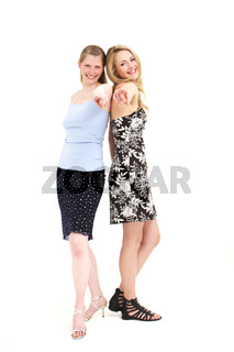 Laughing women pointing at the camera