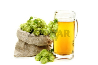 Hop cones and glass of beer.