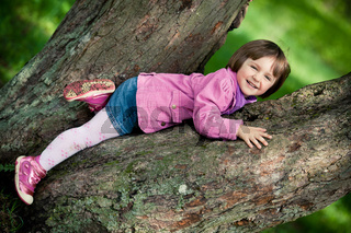 little girl on big tree