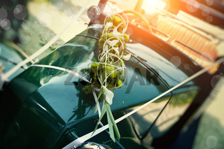 Detail of an old car as a wedding car Bride