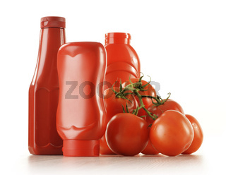 Composition with ketchup and fresh tomatoes isolated on white