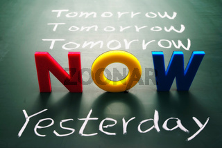 Now, yesterday, and tomorrow words on blackboard
