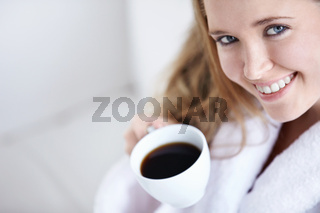 Young girl with a cup of coffee close up