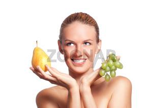 Beautiful redhead girl with fruits