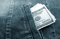 Lot of dollars in a pocket of jeans jacket.