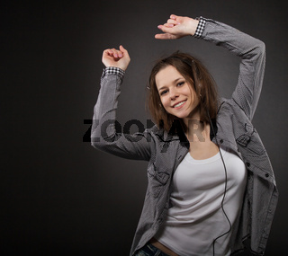 Portrait of the dancing girl wearing headphones