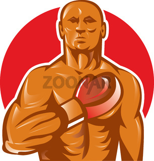 boxer with boxing gloves hand on chest