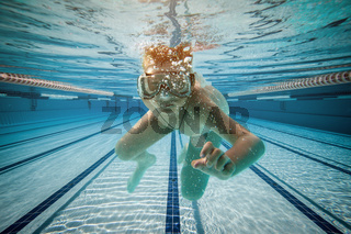 Boy swimming under water