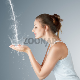 Young woman washing his face