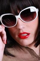 close up of brunette wearing sunglasses