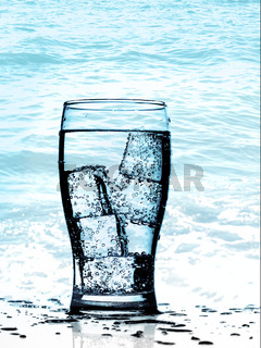 Cold purified water in the glass with bubbles and reflection on the wet background