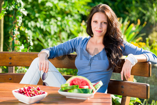 Garden terrace beautiful woman fresh summer fruit