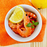Shrimp in a white bowl on orange napkin