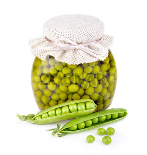 Glass jar of preserved peas and pods isolated on white