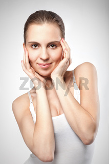 portrait of smiling woman on white