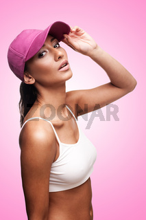 Tan woman in pink cap